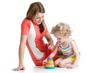 kid girl and mother playing with color toys