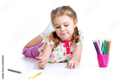 kid girl drawing with pencils