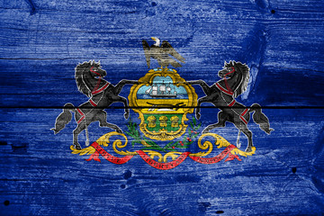 Pennsylvania State Flag painted on old wood plank texture