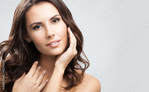 Portrait of beautiful woman, over grey