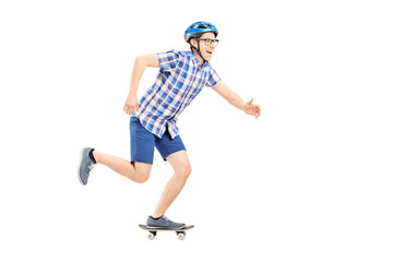 Young man with helmet riding a small skateboard
