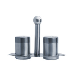 Metal salt and pepper shakers on stand