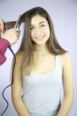 Happy woman getting new hairdo