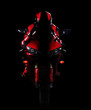Постер, плакат: Motorcyclist in red equipment low key silhouette