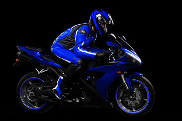 Motorcyclist in blue equipment full length