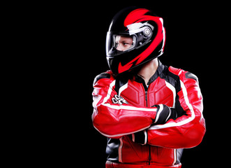 Motorcyclist in red  looking to the copy space area