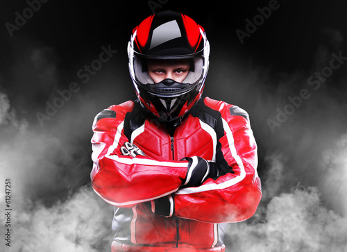Fotobehang Extreme Sporten Motorcyclist standing in smoke on black background