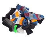 Pile of unsorted socks. Isolated on white