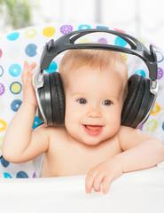 happy baby with headphones