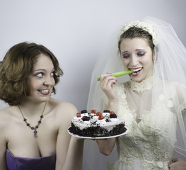 Bride trying to diet is tempted by bridesmaid