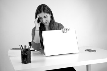 Stressed out woman closing computer