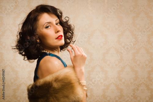 Leinwandbild Motiv Retro woman portrait with cigarette