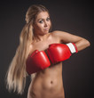 beautiful nude girl with boxing gloves