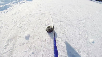 Ice Hockey Dribbling with stick and puck