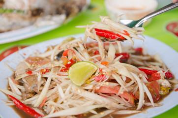 plate of Thai papaya salad also known as som tam