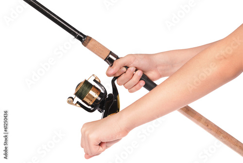 fishing rod, reel in hands