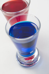 plain blue and red shot drinks