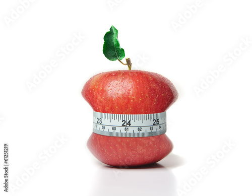 Red apple with green leaf and measuring tape