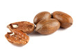 Whole and cracked pecan nuts on white background