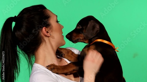 Brunette girl with her doberman puppy