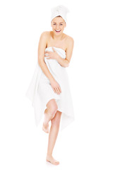 Young woman posing in a towel