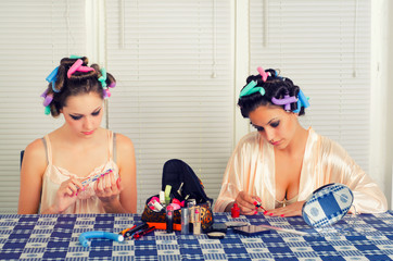 Two young housewives beautifying themselves