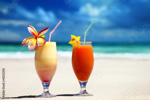 Papiers peints Cocktail fresh fruit juices on a tropical beach
