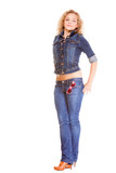 Denim fashion. Full length blonde girl in blue jeans