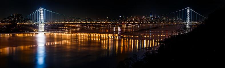 Geoege Washington Bridge and the New York skyline by night