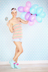 Retro woman with lollipop and balloons