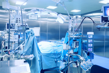 Modern operating room with the patient on the table.
