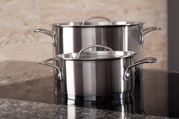 Two aluminum pots on induction hob