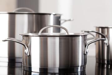 Aluminum pots on the kitchen top