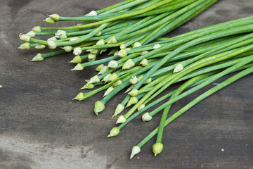 spring onion flower on wooden background