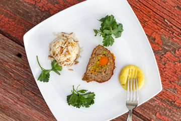 Vegetable Stuffed Meatloaf Served with Rice Pilaf