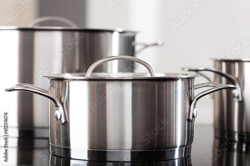Aluminum pots on the kitchen top - 61254676