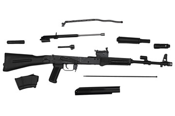 Assault rifle disassembled into parts isolated on white