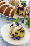 Kugelhopf cake with blueberries and lime, with a glaze.