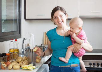 Happy mother with child cooking mashed potatoes