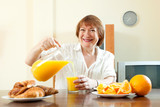 mature  woman having breakfast