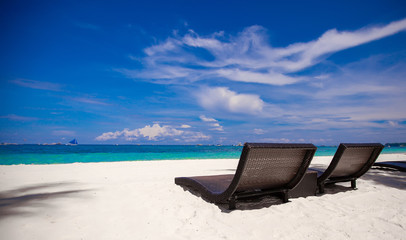 Beach Chairs on beautiful island in white sand plage