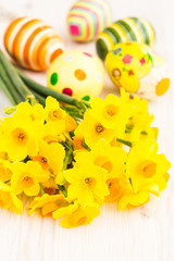 Yellow daffodils with easter eggs