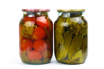 Two glass jars of colorful pickled vegetables
