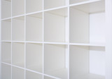 Blank white bookshelf, empty shelves