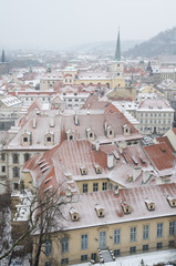 Snowy roofs of Prague