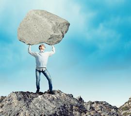 Guy lifting stone