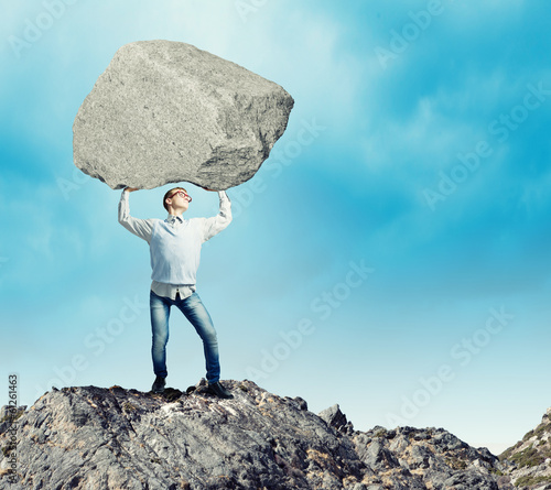 Guy lifting stone