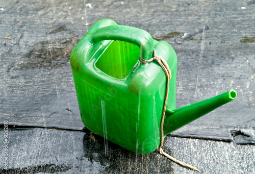 Watering can in the pouring rain