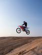 rider performs stunts in desert