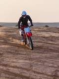 dusty desert racer on a motorcycle